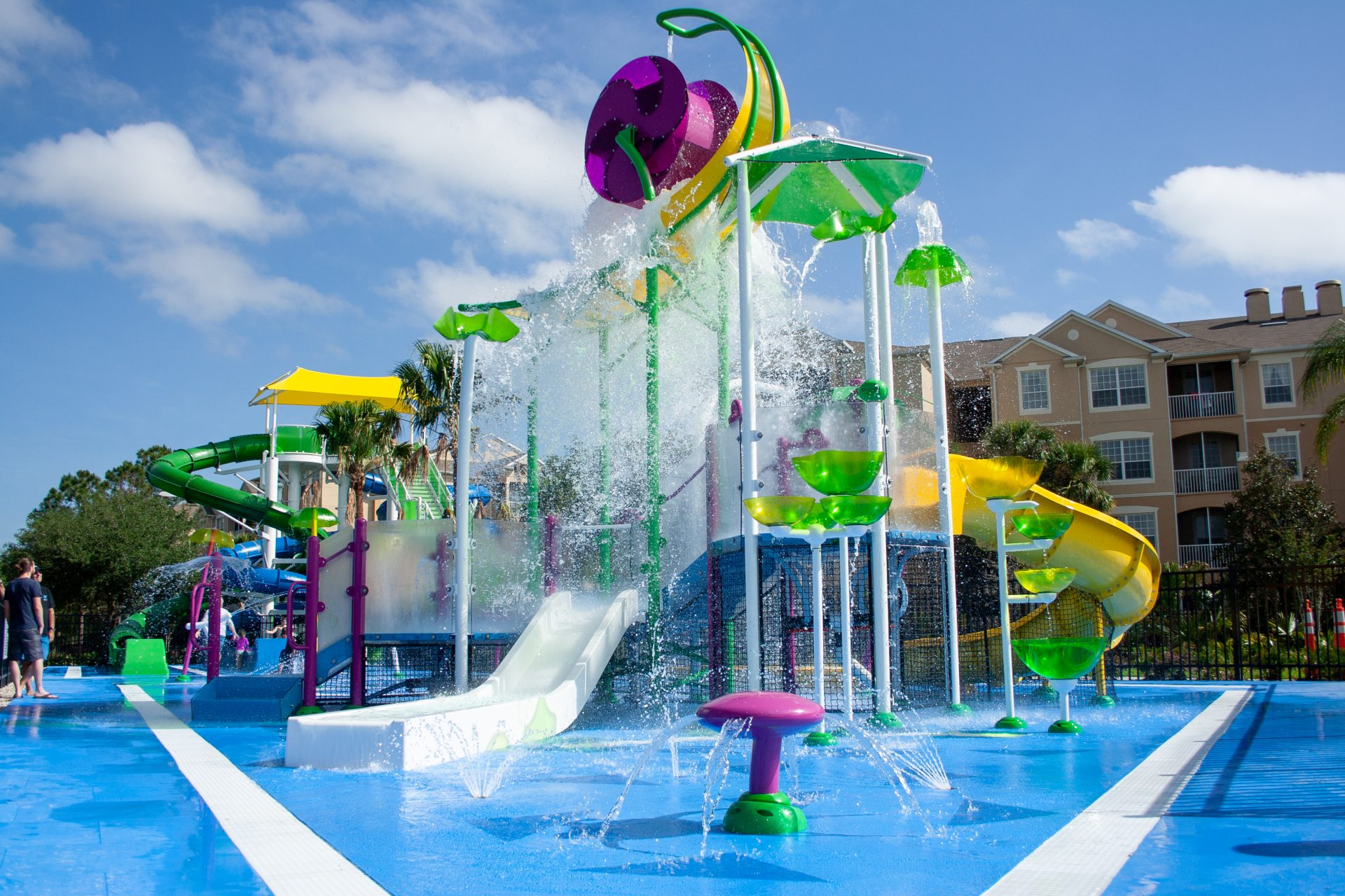 Windsor Hills aquatic play structure with kids slides and water wheel designed by Martin Aquatic