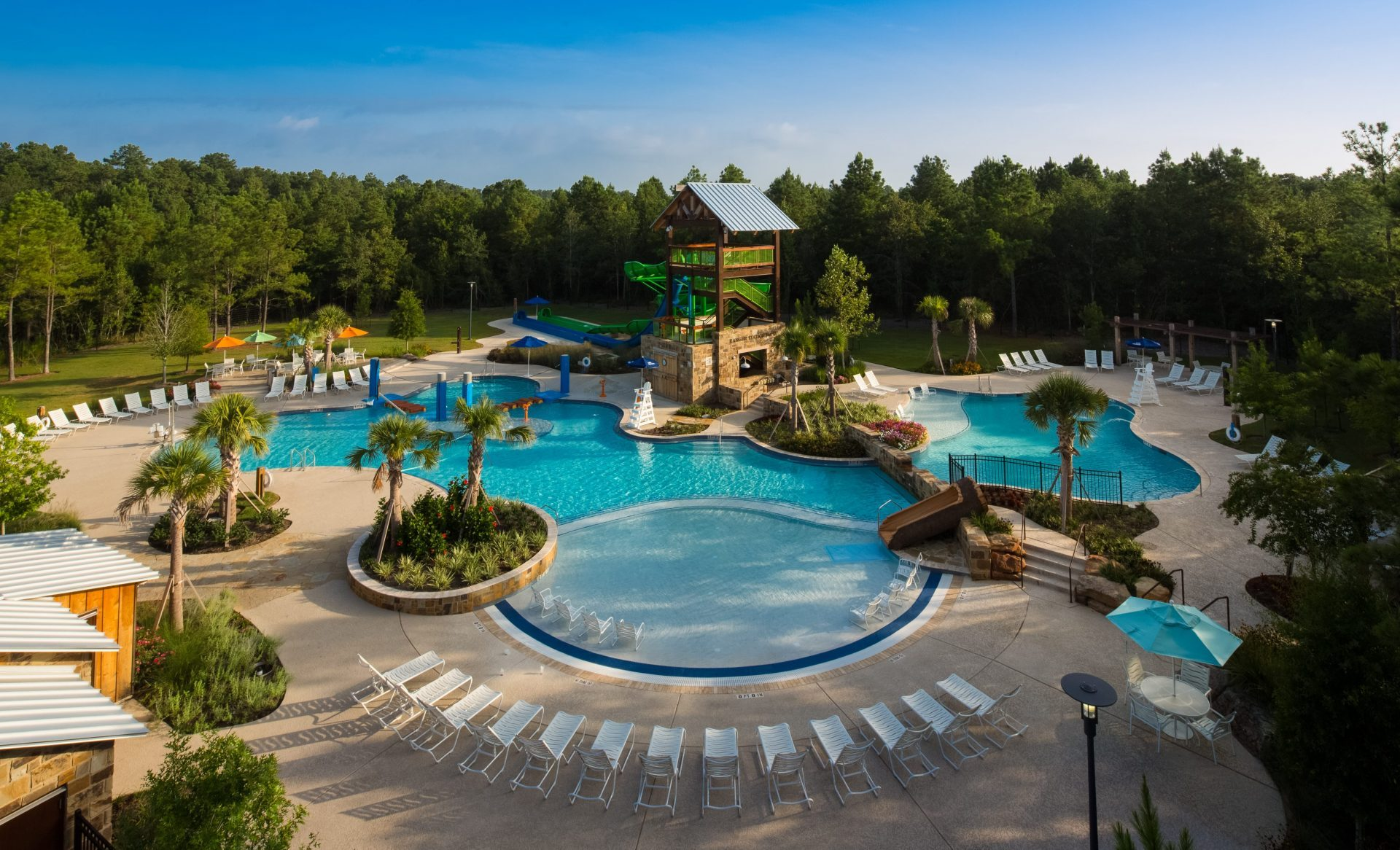 Woodforest Forest Island Pool complex designed by Martin Aquatic offers lounge seating