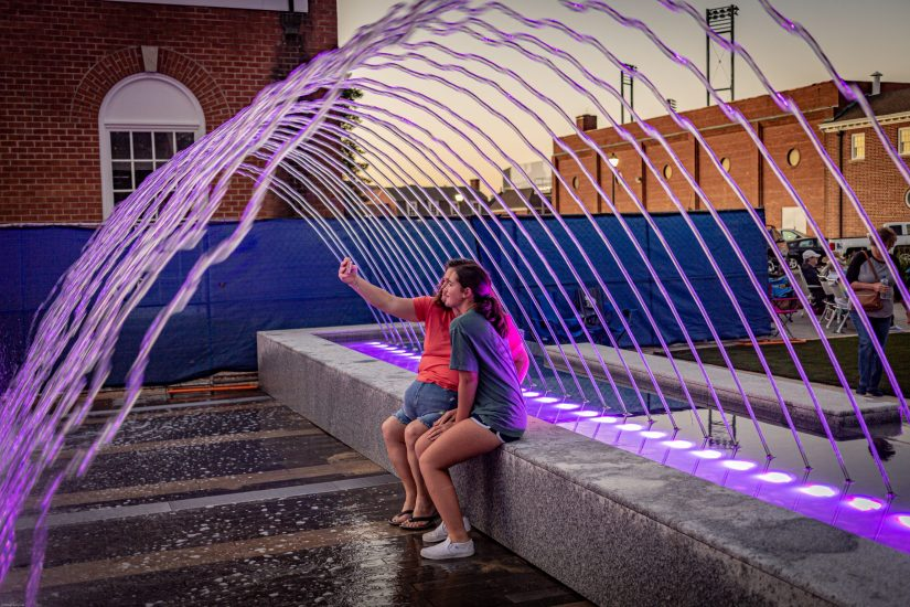 Kannapolis Downtown invites people to sit inside curved fountain sprays