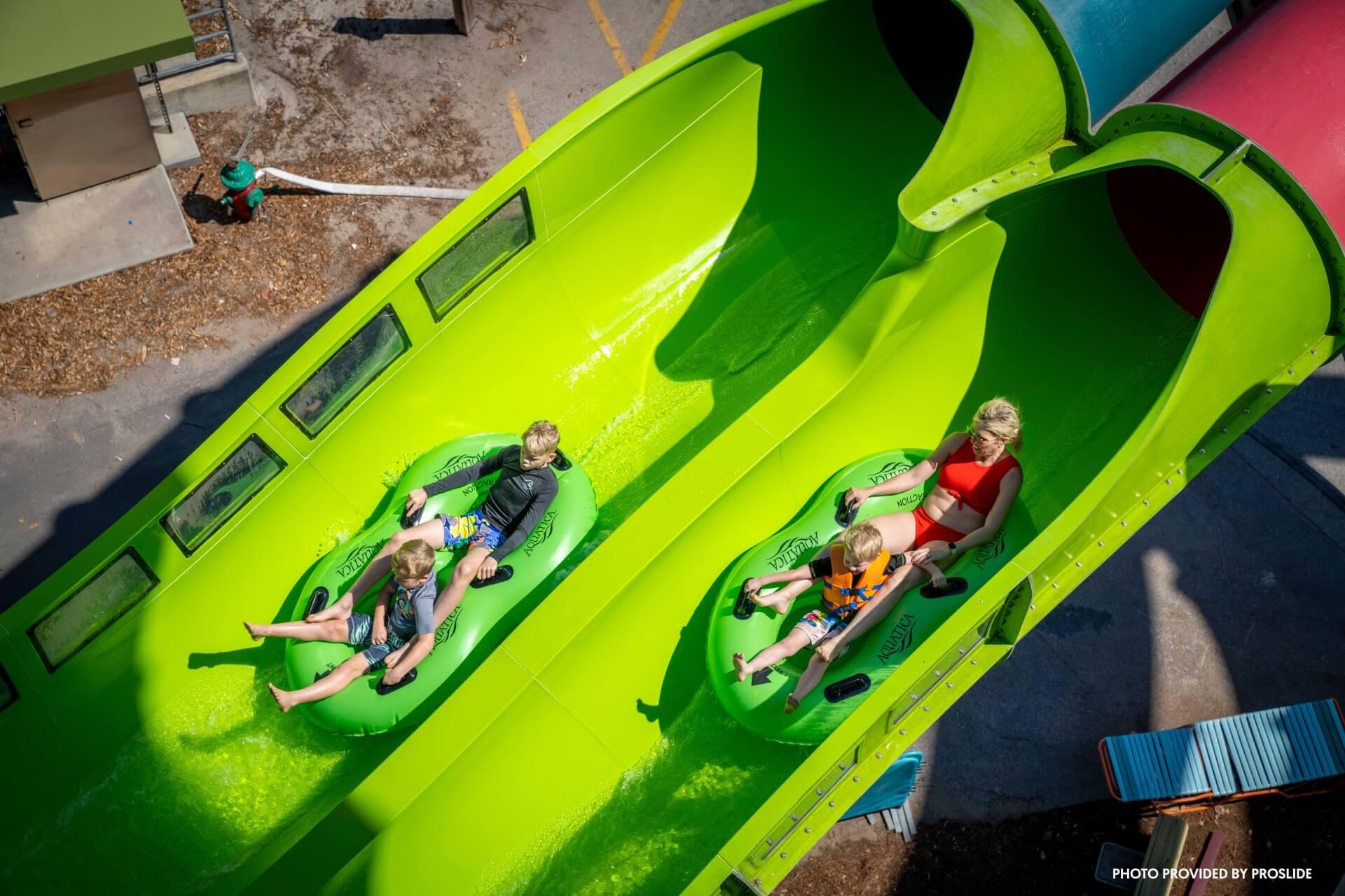 Riders slide side by side on SeaWorld Aquatica Riptide Race